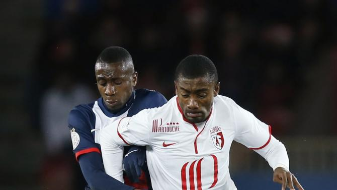 Paris St Germain's Matuidi challenges Lille's Kalou during their French Ligue 1 soccer match in Paris
