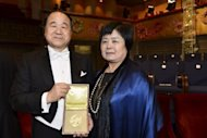 The 2012 Nobel Prize Laureate for Literature Mo Yan (L) with his wife Inlan Du after the Nobel Prize award ceremony at the Stockholm Concert Hall on December 10, 2012. Yan released a new book Friday charting his experience receiving the award in Sweden last December, state media reported