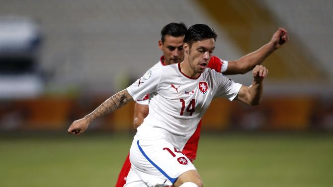 Czech Republic's Kadlec evades Malta's Failla during their 2014 World Cup qualifying soccer match outside Valletta