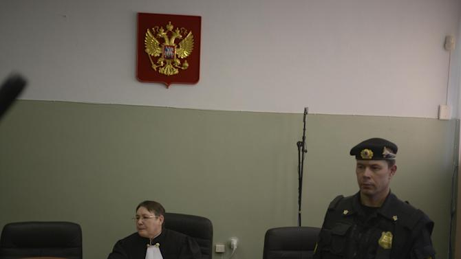 Russian judge Galina Yefremova, left, chairs a court session in a town of Berezniki, some 1500 km (940 miles) north-east of Moscow, Russia, on Wednesday, Jan. 16, 2013. A Russian court on Wednesday turned down the attempt of jailed feminist punk band Pussy Riot member Maria Alekhina to defer serving her sentence until her preschool son becomes a teenager. Alekhina  was convicted last year along with two other band members of hooliganism motivated by religious hatred for an anti-President Vladimir Putin stunt in Russia's main cathedral. (AP Photo/Alexander Agafonov)