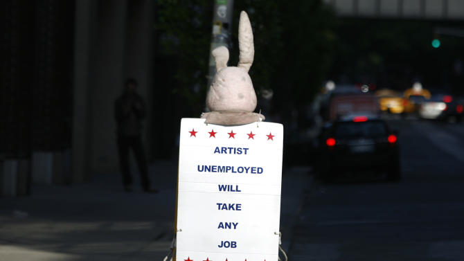 A person dressed as a bunny walks down the street with a sign in New York