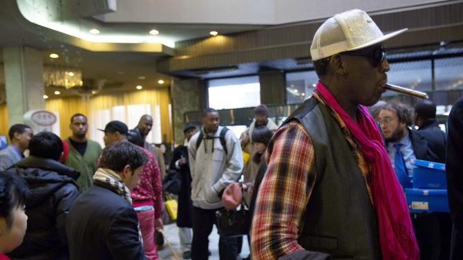 "Former NBA basketball star Dennis Rodman, right, and fellow U.S. basketball players arrive at a hotel in Pyongyang, North Korea Monday, Jan. 6, 2014. Rodman arrived in the North Korean capital with a squad of former basketball stars in what he calls ""basketball diplomacy,"" although U.S. officials have criticized his efforts. (AP Photo/David Guttenfelder)"