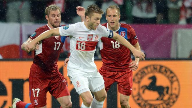 Polish Midfielder Jakub Blaszczykowski (C) Vies With Czech Midfielder Tomas Hubschman (L) And Czech Midfielder Daniel AFP/Getty Images