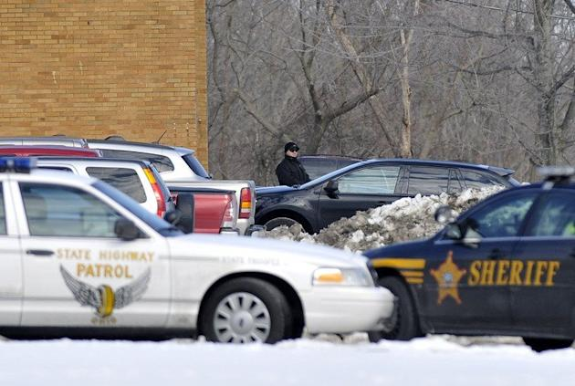 "Police cars are parked in Chardon, Ohio on February 27, 2012. Two US teenagers have been found guilty of raping a fellow high school student -- a case made notorious when a video of boys laughing about the assault on the ""dead"" drunk girl went viral"