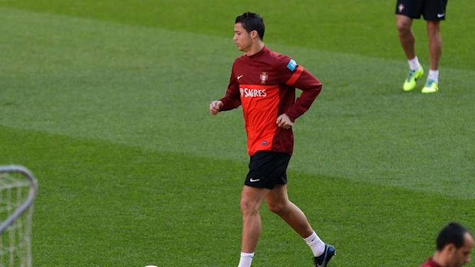 Portugal's Cristiano Ronaldo runs with a ball during a training session Sunday, Nov. 17 2013, at the Luz stadium in Lisbon. Portugal will play Sweden Tuesday in a World Cup qualifying playoff second-leg soccer match