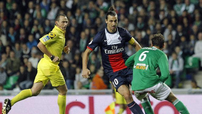 Paris Saint Germain's Zlatan Ibrahimovic, center, challenges for the ball with Saint-Etienne's Jeremy Clement, right, during their French League One soccer match in Saint-Etienne, central France, Sunday, Oct. 27, 2013