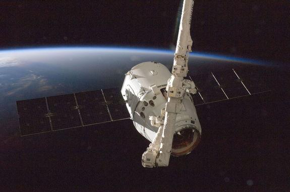 The SpaceX Dragon commercial cargo craft is grappled by the International Space Station's Canadarm2 robotic arm on Oct. 10, 2012 during the spacecraft's first cargo delivery mission for NASA under a $1.6 billion deal for commercial cargo delive