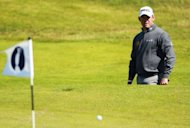 Lee Westwood of England watches his chip shot to the 4th green during a practice round for the 2012 British Open Golf Championship at Royal Lytham & St Anne's in Lytham, north-west England ahead of the Open Championship which begins on July 19