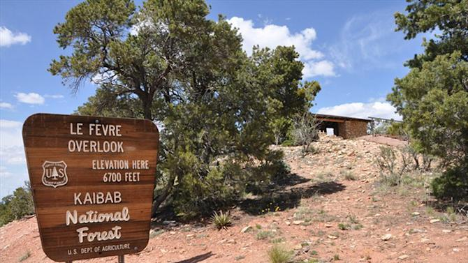 This photo provided by the Coconino County Sheriff's Office shows the sign at the entrance to the Le Fevre Overlook on Highway 89A, some 8 miles north of Jacobs Lake, Ariz. on Wednesday, July 24, 2013. A married couple was killed and a teenage boy injured when lightning struck near the northern Arizona scenic overlook, authorities said Wednesday. (AP Photo/Coconino County Sheriff's Office)