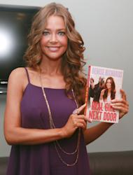 "NEW YORK, NY - JULY 27: Denise Richards poses for photos with her new book ""Real Girl Next Door"" during a taping of ""FOX & Friends"" at FOX Studios on July 27, 2011 in New York City. (Photo by Astrid Stawiarz/Getty Images)"
