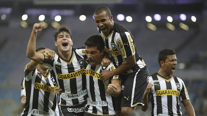 Juan Carlos Ferreyra of Brazil's Botafogo, center, celebrates with teammates after scoring against Ecuador's Independiente del Valle during a Copa Libertadores soccer match in Rio de Janeiro, Brazil, Tuesday, March 18, 2014