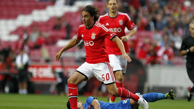 Benfica's Lazar Markovic, foreground, from Serbia, battles for the ball with Belenenses' Joao Pedro Cunha, on the ground, during their Portuguese league soccer match at Benfica's Luz stadium, in Lisbon, Saturday, Sept. 28, 2013