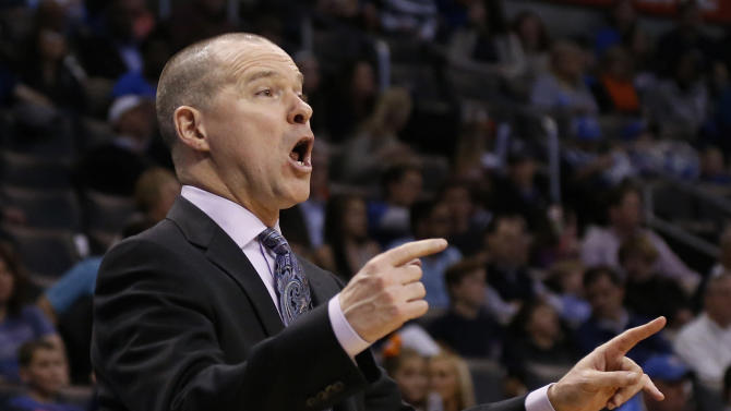Sacramento Kings head coach Michael Malone directs his team in the fourth quarter of an NBA basketball game against the Oklahoma City Thunder in Oklahoma City, Sunday, Jan. 19, 2014. Oklahoma City won 108-93. (AP Photo/Sue Ogrocki)