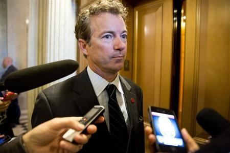 Senator Rand Paul (R-KY) speaks to reporters during the 14th day of the partial government shut down in Washington on October 14, 2013. REUTERS/Joshua Roberts