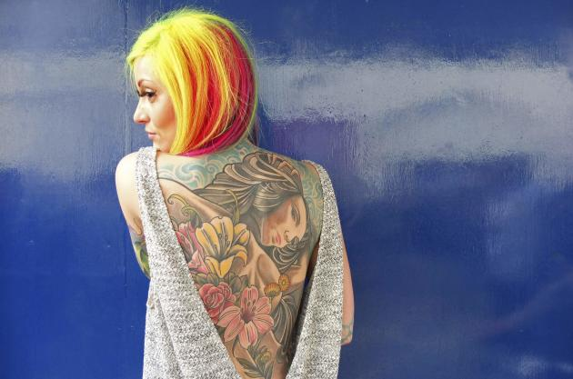Helen Taylor from Stoke-upon-Trent wears a backless top to show off her tattoos (Reuters)