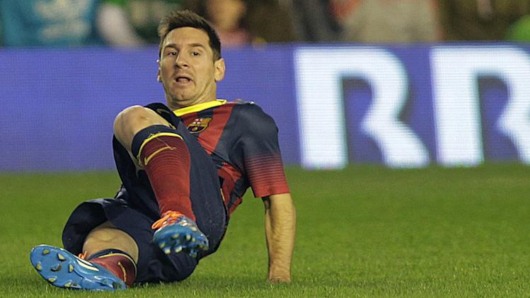 Barcelona's Lionel Messi from Argentina sits on the field during his team's La Liga soccer match against Betis  at the Benito Villamarin stadium, in Seville, Spain on Sunday, Nov. 10, 2013