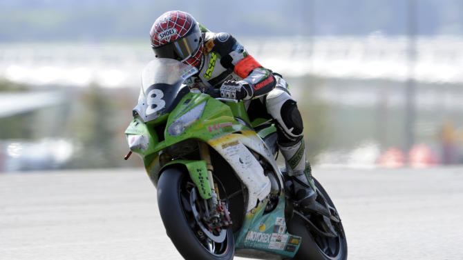 French Jerome Tangre rides his Kawasaki belonging to Bolliger team Switzerland to finish fourth of the 34th edition of Le Mans 24-hour endurance race on September 25, 2011 in the French western city of le Mans. AFP PHOTO DAMIEN MEYER (Photo credit should read DAMIEN MEYER/AFP/Getty Images)