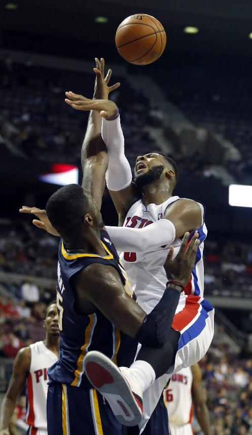 Detroit Pistons center Andre Drummond, right, has his shot blocked by Indiana Pacers center Roy Hibbert, left, during the second half of an NBA basketball game Tuesday, Nov. 5, 2013, in Auburn Hills, Mich. Hibbert blocked seven shots and pulled down 10 rebounds in a 99-91 win over the Pistons
