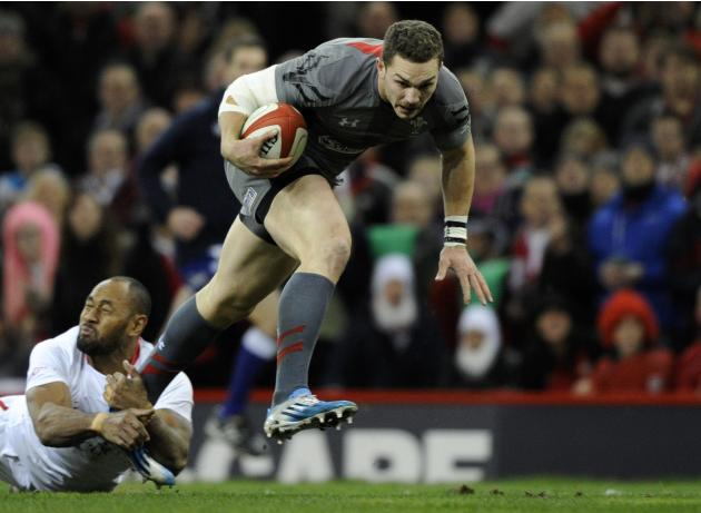 Wales' George North is tackled by Tonga's Vunga Lilo during their international rugby union match at the Millennium Stadium in Cardiff