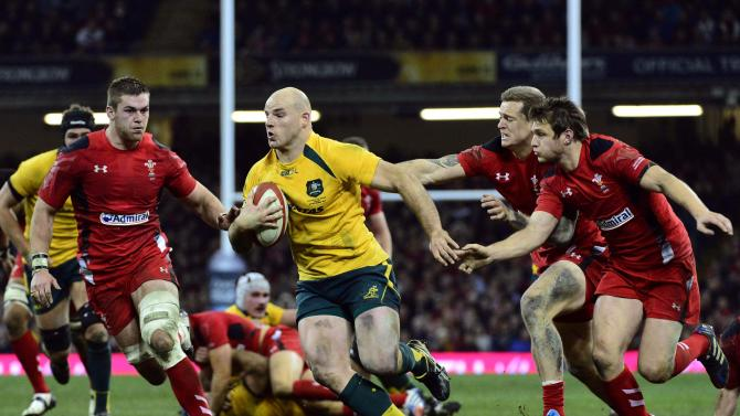 Australia's Moore runs at the Wales defence during their international rugby union match in Cardiff