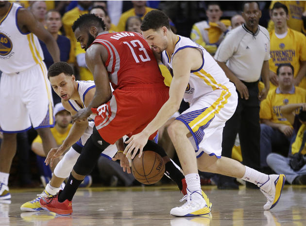Houston Rockets guard James Harden (13) loses the ball on the game's final play as Golden State Warriors guards Stephen Curry, left, and Klay Thompson defend during the second half of Game 2 of th