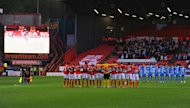LONDON, ENGLAND - APRIL 15: Players, fans and officials observe a minute's silence to mark the 25th anniversary of the Hillsborough disaster prior to the Sky Bet Championship match between Charlton Athletic and Barnsley at The Valley on April 15, 2014 in London, England. (Photo by Mike Hewitt/Getty Images)