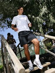 Rafael Nadal attends his first trainning session after a knee injury, in Manacor, on the Spanish Island of Mallorca, on July 20, 2009. Nadal that year lost his French Open and Wimbledon titles, as well as his world number one spot, in a summer of injury misery