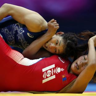 Japan's Saori Yoshida fights Mongolia's Byambatseren Sundev during her women's 55kg freestyle gold medal wrestling match at Dowon Gymnasium during the 2014 Asian Games in Incheon
