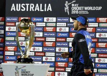 New Zealand's McCullum walks past the Cricket World Cup trophy during the presentation ceremony after losing the final match against Australia at the MCG