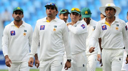 Pakistan captain Misbah-ul-Haq (2L) and teammates leave the field at the end of the second Test against Sri Lanka in Dubai on January 12, 2014