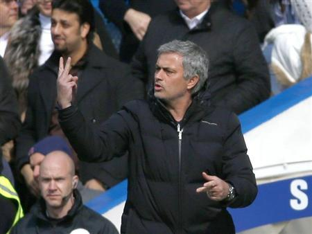Chelsea manager Mourinho gestures during their English Premier League soccer match against Arsenal at Stamford Bridge in London