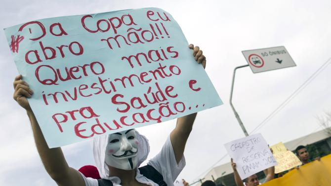 Students hold a demonstration against the World Cup near the Arena Amazonia soccer stadium in Manaus