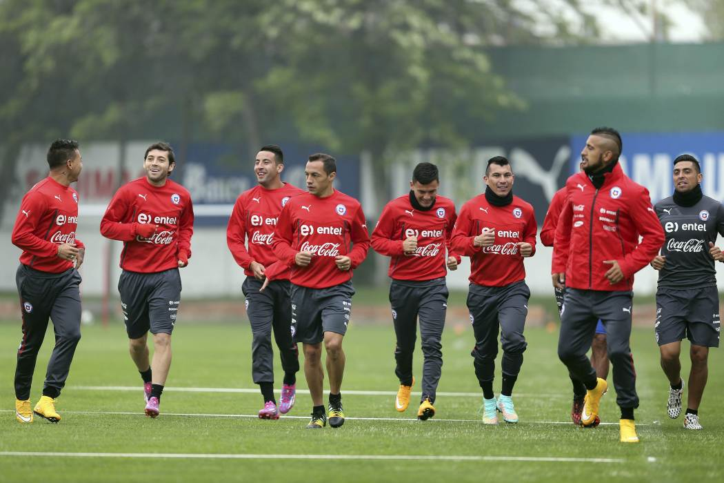 Chile's national soccer team players run during a training session in Santiago