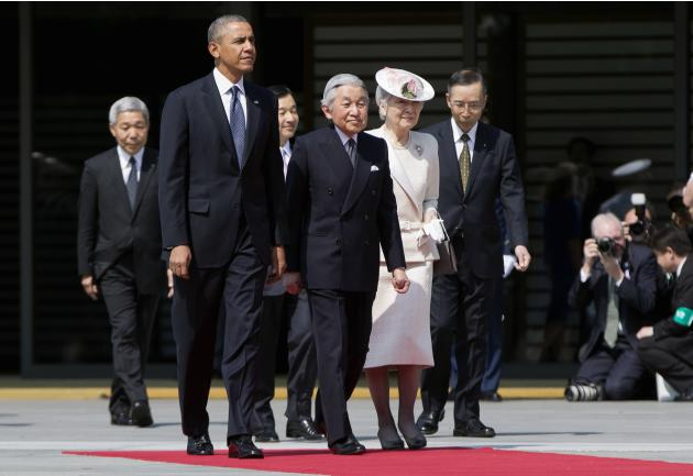 U.S. President Barack Obama walks with Japanese Emperor Akihito and his wife Empress Michiko as he arrives for a welcome ceremony at the Imperial Palace in Tokyo