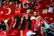Turkish supporters cheer on their side during a Euro 2016 match against Spain at the Allianz Riviera stadium in Nice