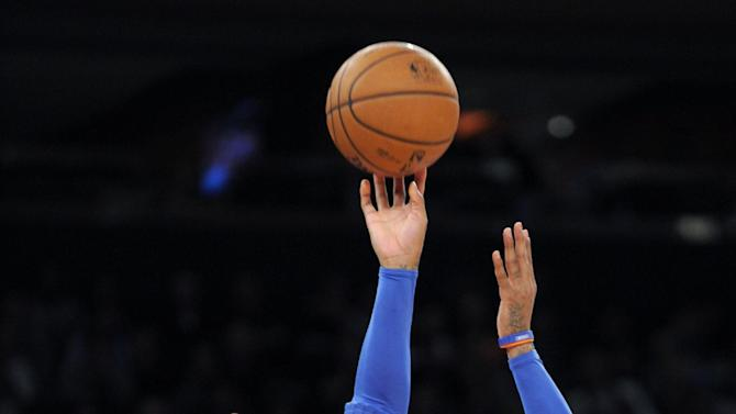 New York Knicks' Carmelo Anthony (7) shoots over Orlando Magic forward Andrew Nicholson (44) during the second quarter of an NBA basketball game on Friday, Dec. 6, 2013, at Madison Square Garden in New York