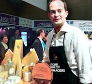 Handout picture shows Britain's Matt Feroze at the French cheese championships in Lyons, east-central France, on January 27, 2013, in which he came first. Little did Feroze know that his month-long working holiday would set him on the path to a whole new potential career and the honour of being the first foreigner to be crowned France's top cheesemonger