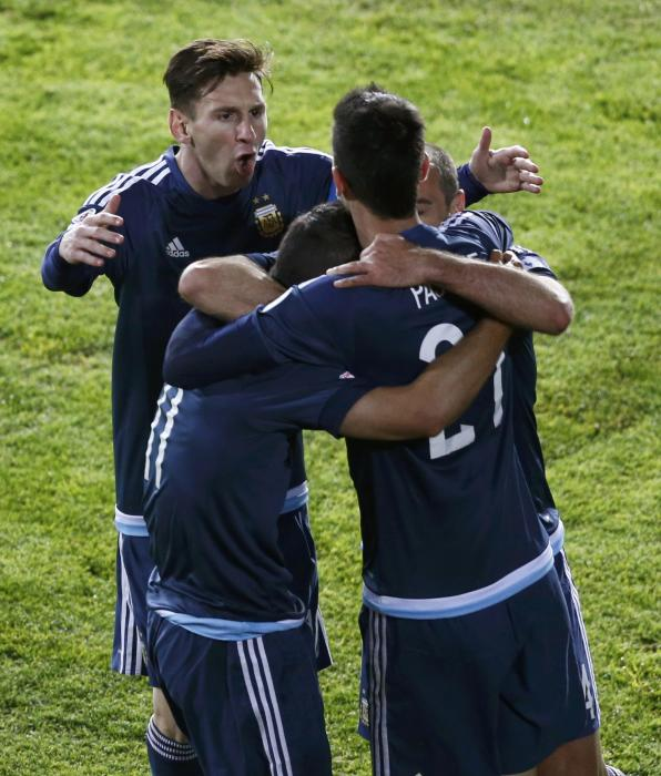 Argentina's Aguero celebrates with Messi and Pastor after scoring against Uruguay during their first round Copa America 2015 soccer match at...