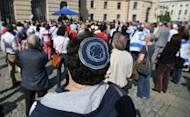 A protester wearing a kippa attends a demonstration for the religious right of circumcision at Bebelplatz in Berlin. Around 500 mainly Jewish but some Christian and Muslim protesters have gathered in Berlin to demand the right to circumcision after a disputed court ruling in Germany outlawing the rite.