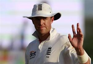 England's Graeme Swann waves at spectators at the end of the second day of first test cricket match against Sri Lanka in Galle