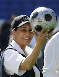 "International Olympic Committee (IOC) chairman of the evaluation commission Moroccan Nawal El Moutawakel holds a Real Madrid soccer ball during the IOC evaluation commission visit to the Santiago Bernabeu Stadium in Madrid on May 6, 2009. Spanish Prime Minister Jose Luis Rodriguez Zapatero said he had a ""reasonable hope"" that Madrid will be chosen to host the 2016 Games as experts from the International Olympic Committee (IOC) began inspecting the city's bid. AFP PHOTO/Pedro ARMESTRE"