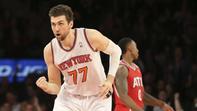 New York Knicks forward Andrea Bargnani (77) pumps his fist after scoring during the second half of an NBA basketball game against the Atlanta Hawks, Saturday, Dec. 14, 2013, in New York. The Knicks won 111-106