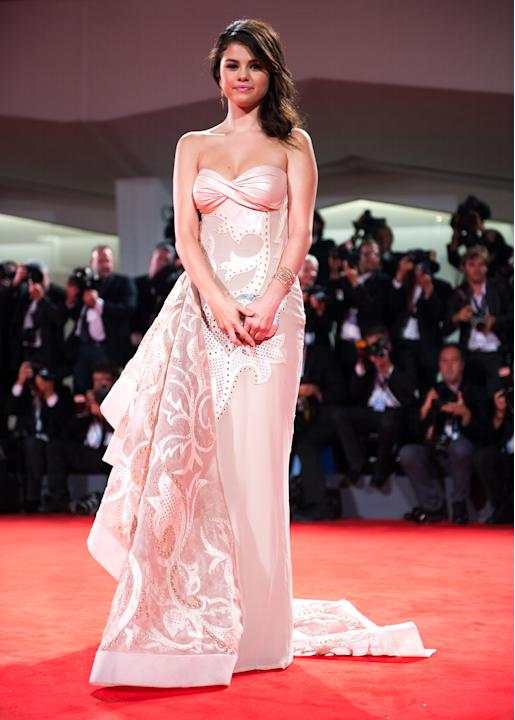 """Selena Gomez looked grown-up and gorgeous at the 69th Annual Venice Film Festival premiere of """"Spring Breakers"""" on September 5, 2012. The 20-year-old former Disney star wore a stunning strapless Versa"""
