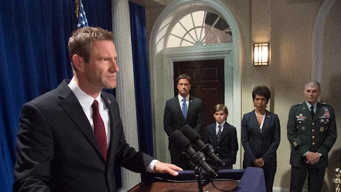 "This film image released by FilmDistrict shows, from left, Aaron Eckhart, Gerard Butler, Finley Jacobsen, Angela Bassett and Robert Forster in a scene from ""Olympus Has Fallen."" (AP Photo/FilmDistrict, Phil Caruso)"