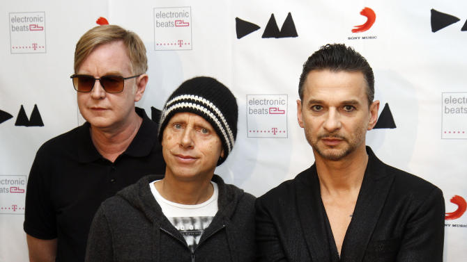 "FILE - This March 24, 2013 file photo shows, from left, Andrew Fletcher, Martin Gore and Dave Gahan, from Depeche Mode at the  Depeche Mode Delta Machine Album launch in Vienna, Austria. Depeche Mode's dark, electronic grooves are all over ""Delta Machine,"" the trio's 13th release, out this week. (AP Photo/Ronald Zak, file)"