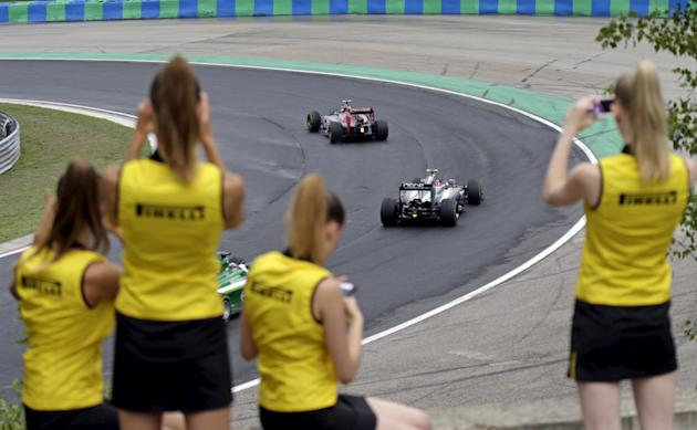 File photo of Pirelli hostesses taking pictures as drivers compete during the Hungarian F1 Grand Prix at the Hungaroring circuit, near Budapest