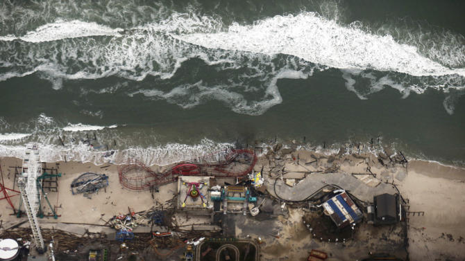 In this aerial photo, debris from an amusement park destroyed during Superstorm Sandy lines the beach in Seaside Heights, N.J. Thursday, Nov. 1, 2012.  The photo was taken during a flight to document coastal changes by the National Oceanic and Atmospheric Administration after the storm moved through the area. (AP Photo/Alex Brandon)