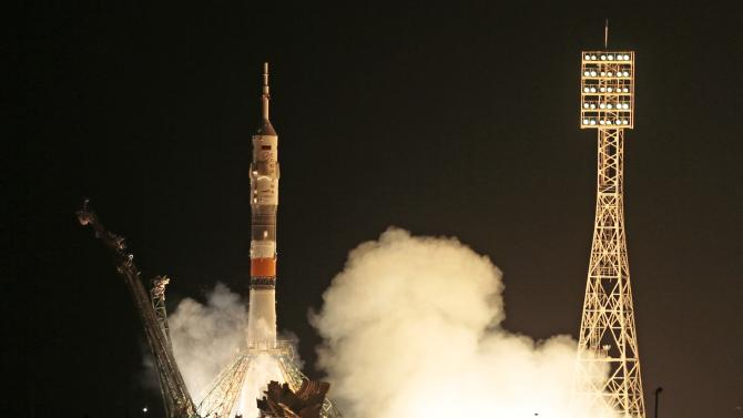 The Soyuz-FG rocket booster with Soyuz TMA-09M space ship carrying a new crew to the International Space Station, ISS, blasts off at the Russian leased Baikonur cosmodrome, Kazakhstan, Wednesday, May 29, 2013. The Russian rocket carries U.S. astronaut Karen Nyberg, Russian cosmonaut Fyodor Yurchikhin, and European Space Agency astronaut Luca Parmitano.  (AP Photo/Mikhail Metzel)