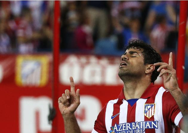 Atletico Madrid's Costa celebrates his goal during their Spanish first division soccer match against Elche at Vicente Calderon stadium in Madrid