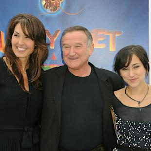 """FILE - In this Nov. 13, 2011 file photo, Susan Schneider, from left, Robin Williams, and Zelda Williams arrive at the premiere of  """"Happy Feet Two"""" at Grauman's Chinese Theater, in Los Angeles. Attorneys for Robin Williams' wife and children are headed to court in their battle over the late comedian's estate. The attorneys are scheduled to appear before a San Francisco probate judge on Monday, as they argue over who should get clothes and other personal items the actor kept at one his Northern California homes. In papers filed in December, Williams' wife, Susan, says some of the late actor's personal items were taken without her permission. She has asked the court to set aside the contents of the home she shared with Williams from the jewelry, memorabilia and other items Williams said the children should have.  (AP Photo/Katy Winn, File)"""